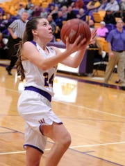 Wylie's Mary Lovelace finishes off a steal and score
