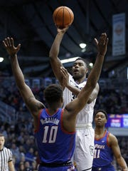 Butler Bulldogs forward Kelan Martin (30) shoots over DePaul Blue Demons forward Tre'Darius McCallum (10) in the first half of their game at Hinkle Fieldhouse Saturday, Feb 3, 2018.