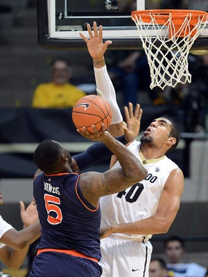 Auburn's Cinmeon Bowers (5) attempts a shot over Colorado's Josh Scott during the first half of an NCAA college basketball game, Monday, Nov. 17, 2014, at the Coors Event Center in Boulder, Colo. Colorado won 90-59. (AP Photo/The Daily Camera, Cliff Grassmick)
