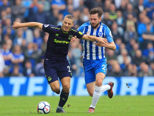 Everton's Nikola Vlasic, right, and Brighton & Hove Albion's Shane Duffy chase the ball during their English Premier League soccer match at the AMEX Stadium in Brighton, England, Sunday Oct. 15, 2017. (Gareth Fuller/PA via AP)