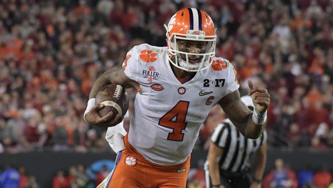 Clemson Tigers quarterback Deshaun Watson (4) runs the ball against the Alabama Crimson Tide during the fourth quarter in the 2017 College Football Playoff National Championship Game at Raymond James Stadium.