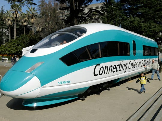 This Feb. 26, 2015, photo shows a full-scale mock-up of a high-speed train, displayed at the Capitol in Sacramento.