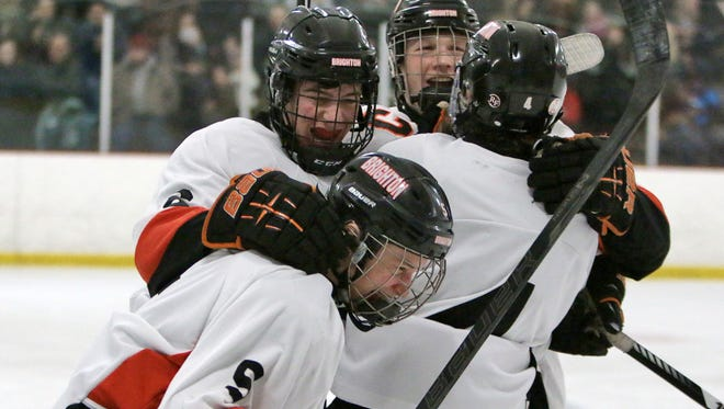 Sam Brennan is swarmed by his Brighton teammates after scoring in the second period on Saturday. The Bulldogs made it stand up for a 1-0 win in the KLAA championship game against Hartland.