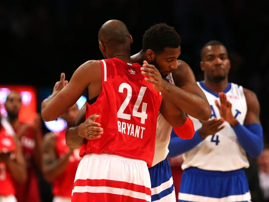 Kobe Bryant #24 of the Los Angeles Lakers and the Western Conference hugs Andre Drummond #0 of the Detroit Pistons and the Eastern Conference as he leaves the game in the fourth quarter during the NBA All-Star Game 2016 at the Air Canada Centre on February 14, 2016 in Toronto, Ontario.