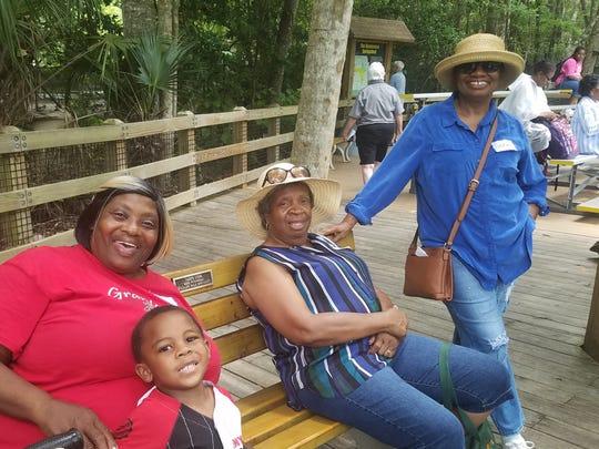 Martha Beverly, her grandson, Brenda Smith and Genice Harris enjoy fun and friendship on a GaP Field Trip.