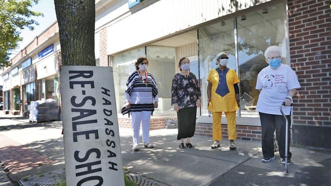 Hadassah Women members Kathy Belt, Marilyn Lubarsky, Regeline Montes and Gladys Petkun in front of the closed shop. The Hadassah Re-Sale Shop in Quincy has closed after 60 years due to the challenges of COVID-19.