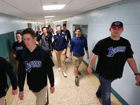 Bulldogs Mike Lepczynski, l, Jordan Gosdick and Matt Volpe lead Metuchen and Middlesex baseball players in a tour as the high schools conduct an 'Athlete Exchange' involving five baseball players from each school, the players spending the school day together at Metuchen High School. The  program is designed to build camaraderie and to instill mutual respect between the sports programs at both schools. April 17, 2018. Metuchen, NJ.