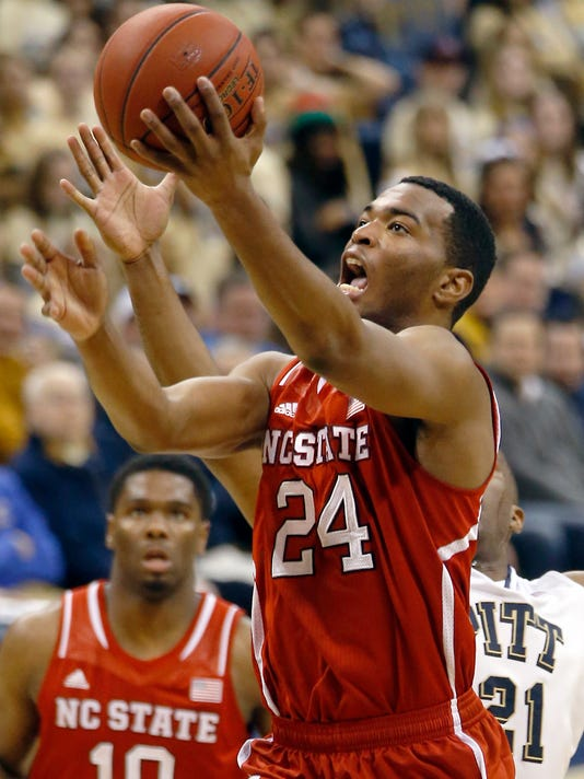 North Carolina State's T.J. Warren (24) shoots in front of Pittsburgh's Lamar Patterson (21) during the second half of an NCAA college basketball game on Monday, March 3, 2014, in Pittsburgh. (AP Photo/Keith Srakocic)
