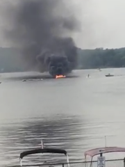 A boat in Lake Mahopac became engulfed in flames after police believe its engine overheated on Friday afternoon.