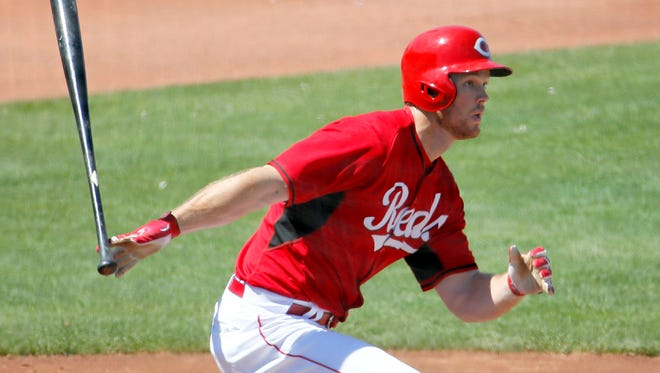 Cincinnati Reds' Brennan Boesch follows through on a two-RBI double during the first inning of a spring training baseball game against the Chicago Cubs, Saturday, March 28, 2015, in Goodyear, Ariz. (AP Photo/Matt York)