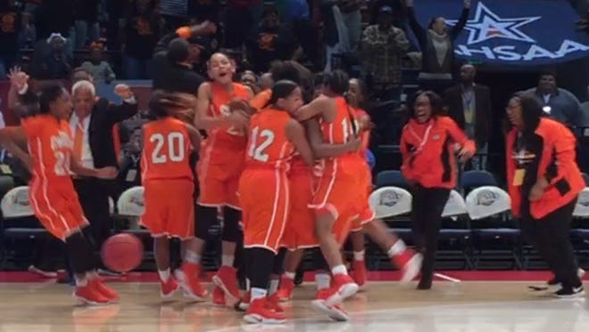 The R.A. Hubbard Chiefs surround Alexandria Orr after her no-time free throw won the Class 1A championship Thursday in Birmingham.