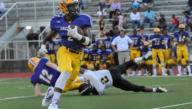 Byrd's Javien Wilson runs the ball in their football jamboree game against Fair Park at Shreveport's Lee Hedges Stadium.