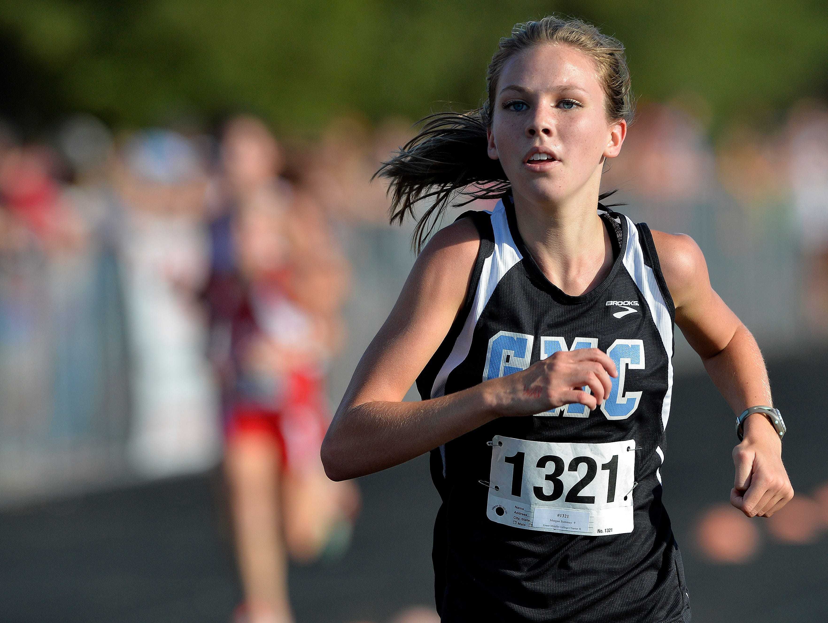 Greer Middle College's Morgan Summey wins the girls varsity Canned Food 5k cross country race at Hillcrest High School on Wednesday, September 23, 2015.