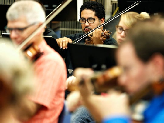 Springfield Symphony Orchestra musicians perform during