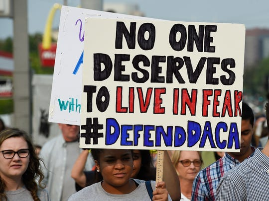 Supporters of Deferred Action for Childhood Arrivals march from Centennial Park to the offices of Sens. Bob Corker and Lamar Alexander on Tuesday, Sept. 5, 2017, in Nashville.