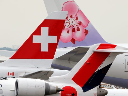 Aircraft with logos are seen at the Paris Air Show