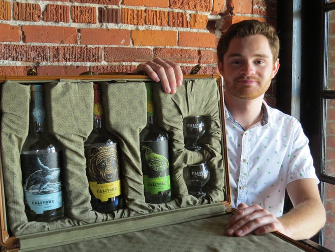 Aaron Bergh, president of Calivore Spirits, poses with