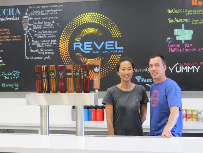 Revel owners Sonia and Adam Gallegos pose behind the