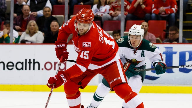 Red Wings center Riley Sheahan skates with the puck against the Minnesota Wild in March.