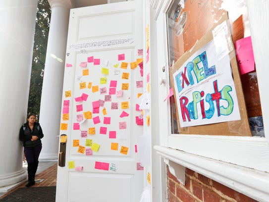 A University of Virginia student looks over postings