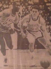 Purcell Marian guard Monte Mathis dribbles against