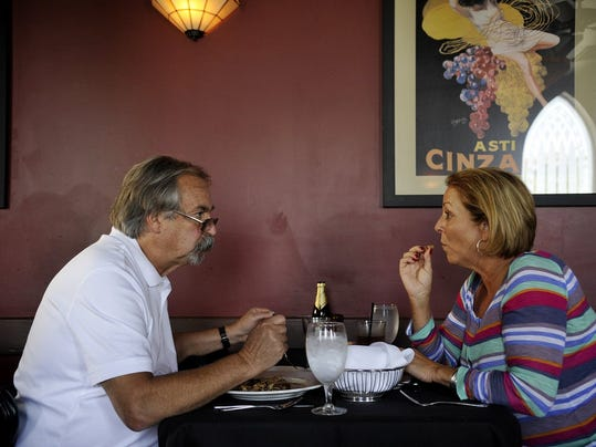 Dave and Jane Chalker of Springettsbury Township share a dish of sauteed mushrooms with bread on Friday, Aug. 23, 2013, at Victor's Italian Restaurant in Spring Garden Township. Victor's Italian Restaurant on Ogontz Street for Cheap Eats.