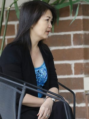 Naly Vang, the wife of the man authorities say killed four people on March 22, speaks to a reporter at The Women's Community.