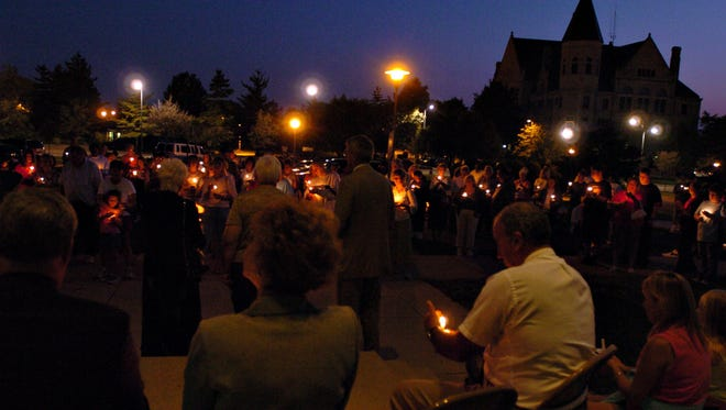 A past National Alliance for Mental Illness (NAMI) East Central candlelight service at the Richmond Municipal Building.