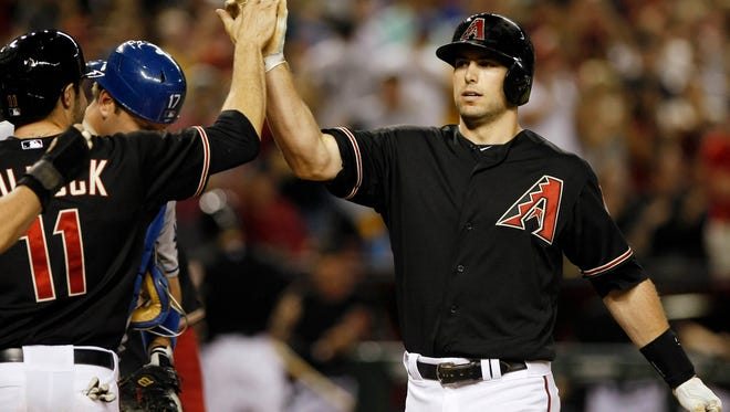 Diamondbacks first baseman Paul Goldschmidt celebrates after hitting a three-run home run against the Los Angeles Dodgers in the seventh inning at Chase Field on Saturday night.