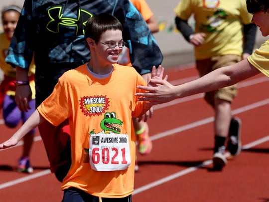 Boys and girls near the finish line during the 33rd annual Awesome 3000 for the Salem-Keizer Education Foundation at McCulloch Stadium at Bush's Pasture Park in Salem on Saturday, May 2, 2015.