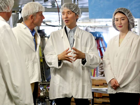 Rep. Kurt Schrader (from left), Wontae Ahn, the director of strategic purchasing with the Korean company G & L Food, and Jung Sun Hee, the president of the Korean company Sulbing, take a factory tour during an international trade meeting at Oregon Fruit Products in West Salem on Thursday, May 28, 2015.