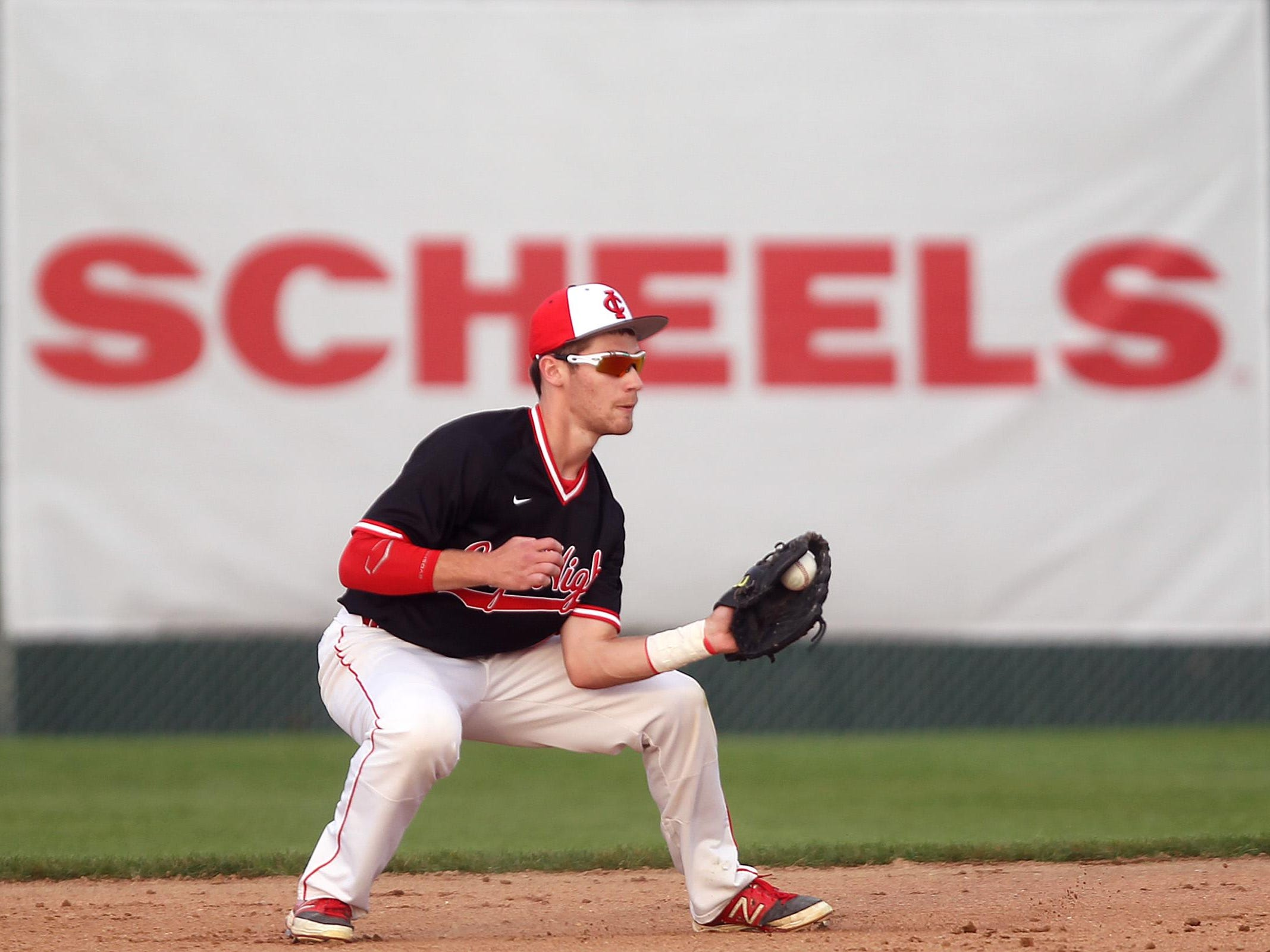 City High's Dylan Leigh pulls in a ground ball. The Little Hawks have six games to play in the regular season.
