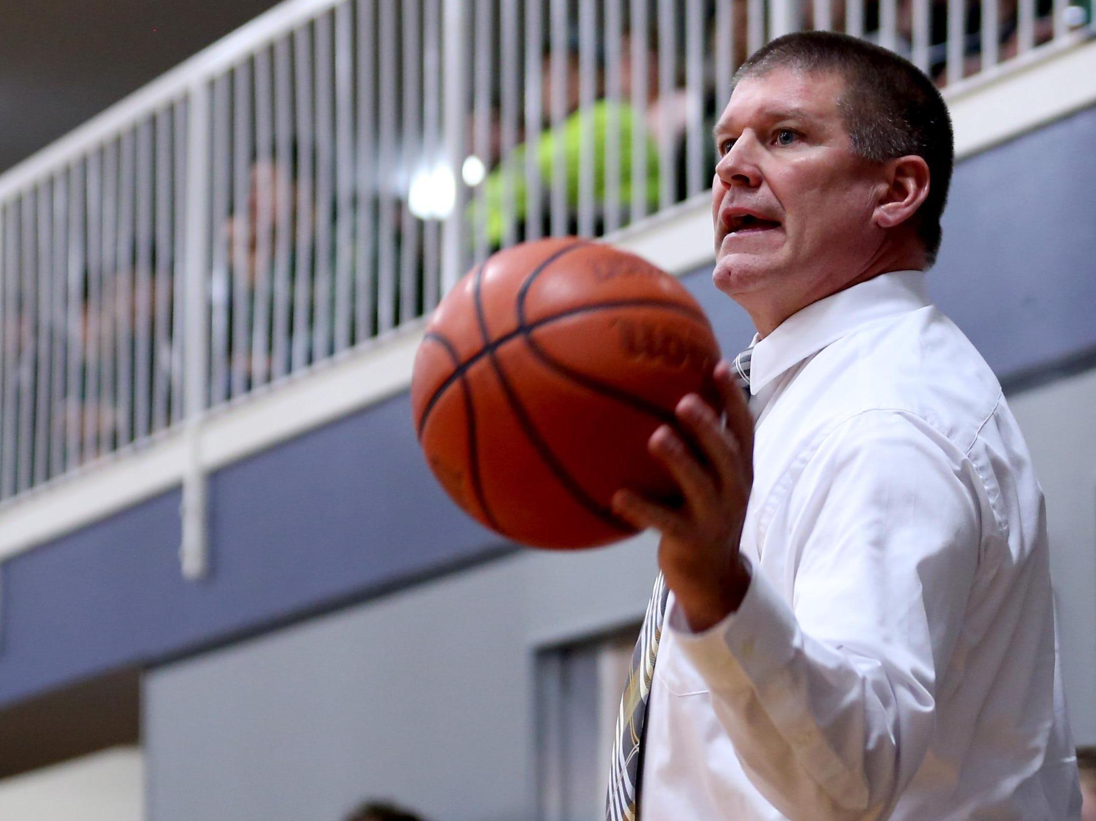 Regis head coach Stuart Alley puts the ball back in play in the Regis vs. Western Mennonite girl's basketball game at Western Mennonite High School on Wednesday, Feb. 17, 2016.
