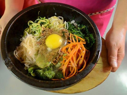The restaurant namesake, bibimbap, a traditional Korean dish, served at Bibimbap House on Chemeketa Street in downtown Salem on Thursday, Dec. 11, 2014.