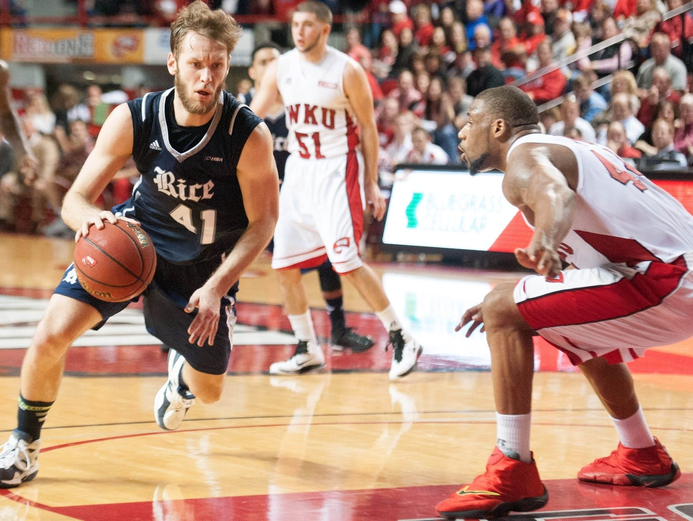 Feb 7, 2015; Bowling Green, KY, USA; Rice Owls forward Seth Gearhart (41) drives the ball away from Western Kentucky Hilltoppers forward George Fant (44) during the second half at E.A. Diddle Arena.