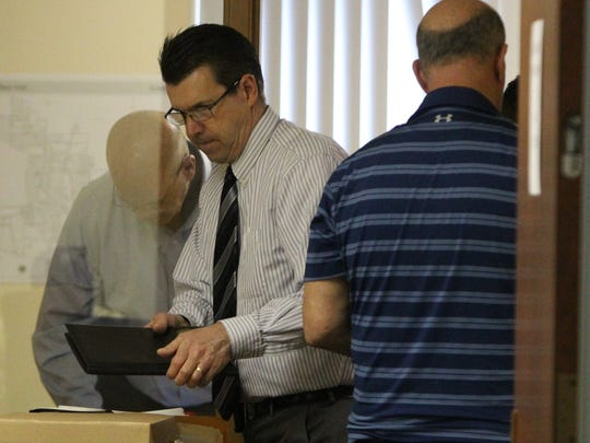 Investigators seize boxes of records from the Village