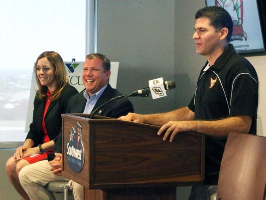 Francisco Gamez, right, co-founder of the Mexican Baseball Fiesta speaks during a press conference Thursday announcing the second annual El Paso event will be held September 25 and 26 at Southwest University Park. With him was Brad Tayor, center, El Paso Chihuahuas general manager and Hazel Kennedy Ledezma, left, of GECU, sponsor of the event.
