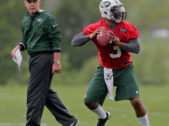 New York Jets quarterback Tajh Boyd steps back to pass as quarterbacks coach David Lee looks on during the team's NFL football rookie camp, Friday, May 16, 2014, in Florham Park, N.J. Boyd was a sixth-round draft selection from Clemson. (AP Photo/Julie Jacobson)
