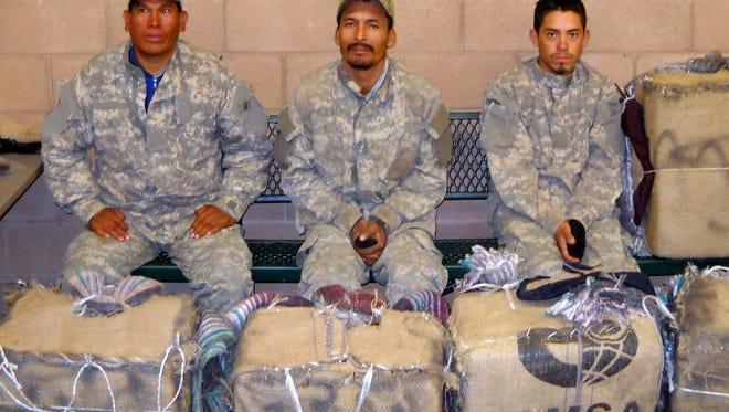 These three unidentified suspects were apprehended in Hidalgo County carrying home-made back packs filled with bundles of marijuana.