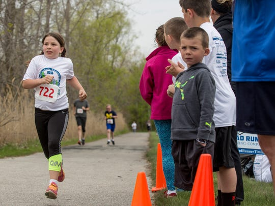Kaitlyn Shafran, 8, runs to the finish line during the K's for Kids fun run Saturday, May 21, 2016 at the Fort Gratiot Nature Trail. Proceeds from the event benefit the Port Huron Schools Endowment Fund.
