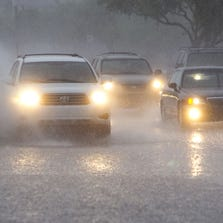 Drivers make their way through flooded streets in Fountain Hills.