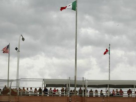 People standing on the Paso Del Norte border bridge