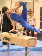 San Angelo Central's Wayne Hines (pictured here on pommel horse) placed first on still rings Saturday at the District 3-6A Gymnastics Championships in Odessa.