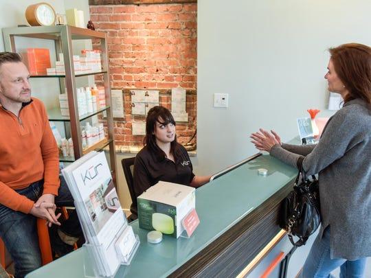 Marina Nonnenmacher (right), Middletown, talks with Kur Wellness Studios owner Troy Teeboom (left) and employee Carolyn Hodge.