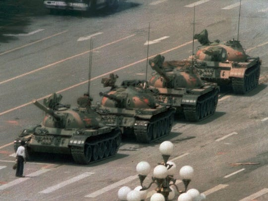 A Chinese man stands alone to block a line of tanks in Beijing's Tiananmen Square in this June 5, 1989 file photo.