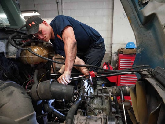 Shaun Kacsmar, a mechanic at Carey Diesel, Inc. works