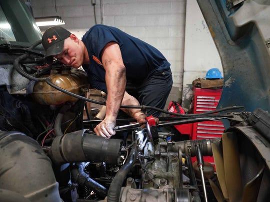 Shaun Kacsmar, a mechanic at Carey Diesel, Inc. works