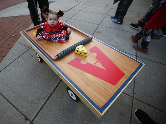 Lunden Johnson, 1, is a mouse in a mouse trap for the