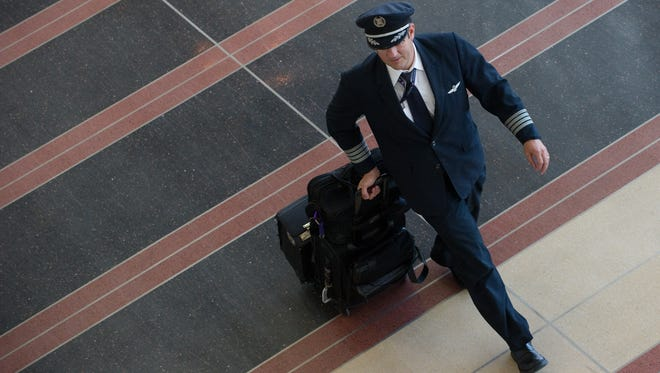 An airline pilot walking through the terminal at Ronald Reagan Washington National Airport in Arlington, Virginia.