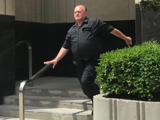 Towing titan Gasper Fiore of Grosse Pointe Shores leaves U.S. District Court in Detroit on June 28, 2017 after meeting with a pretrial officer. He was indicted May 31, 2017  on bribery and fraud charges for his alleged role in a broader public corruption probe.